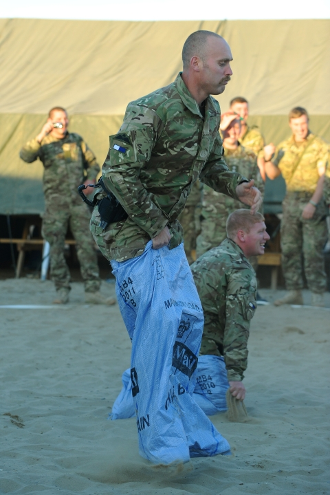 WO2 Kevin Dade from Catterick takes part in a sack race on Christmas Day in main operating base (MOB)  Lashkar Gah, Helmand Province