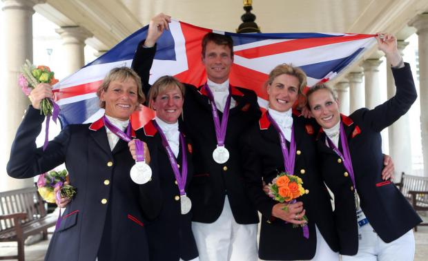 BIG DAY: From left, Mary King, Nicola Wilson, William Fox-Pitt, Tina Cook and Zara Phillips celebrate with their Silver medal