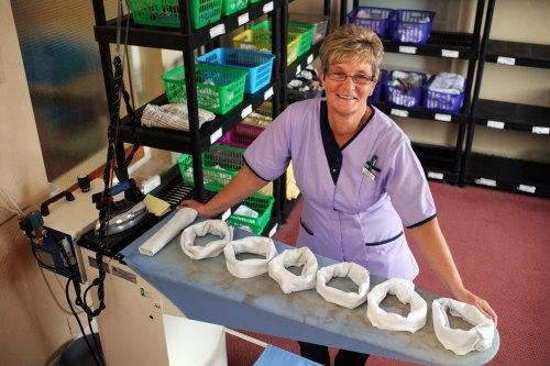 MARKING A MILLION: Val Robson in her highly-organised laundry room