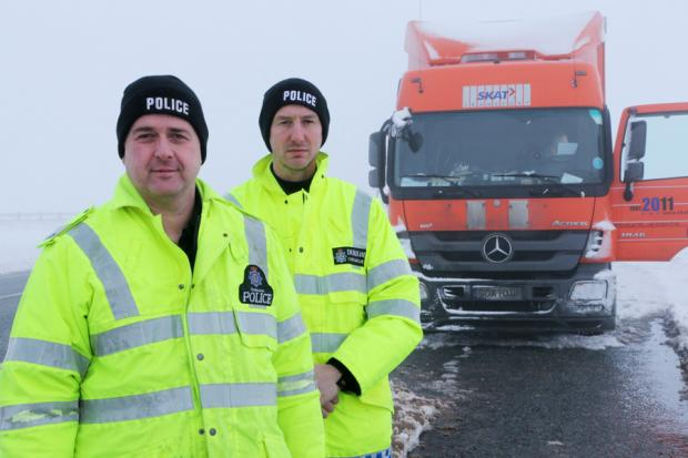Traffic officers Gary Emerson, left and Nick Downing at the scene