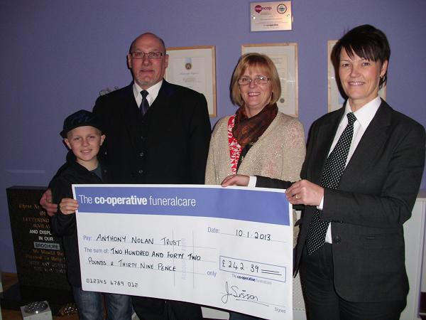 Darlington and Stockton Times: Peter,Phil and Helen Dunnington-Waters with fundraising funeral director Andrea Todd show the cheque for £242.39