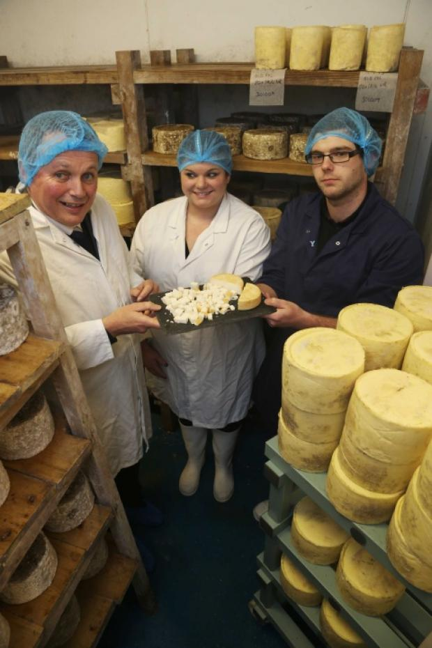 CHEESE TRIBUTE: David Shields (left) with Louise and Sam Reed