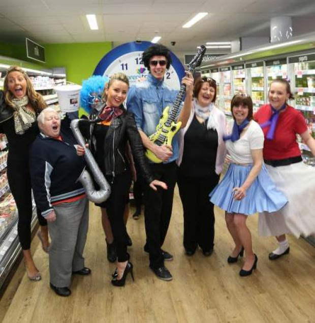 Rock around the Clock fundraisers at the Co-op store in Darlington from left Kirsty Christie, Pat Buttle, Marie Welch, Elizabeth Hutchinson, Joe Watson, Kay Obinu, Vivienne Rees and Natalie Lowes.