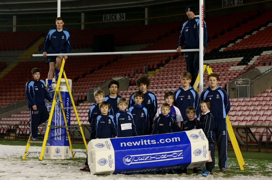 NICE TRY: Squad members from Mowden Rugby Club's academy help with the new goal posts at The Northern Echo Darlington Arena