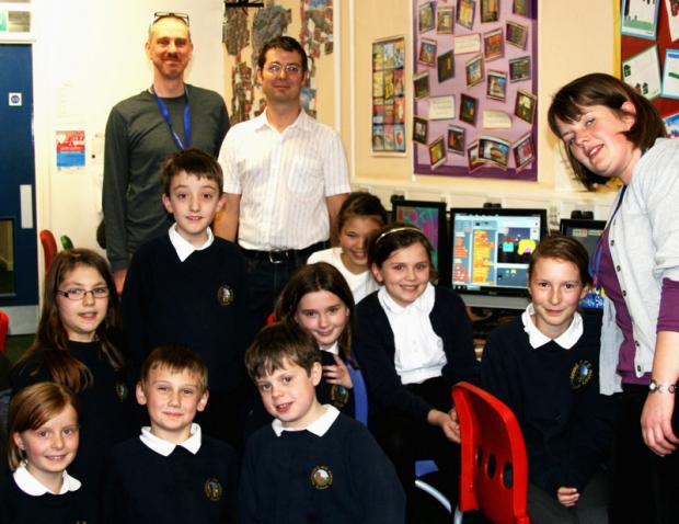 KEYED IN: Pete Hall and Alistair McLean from CitySecret and teacher Lucy Hodges with pupils from Richmond C of E school