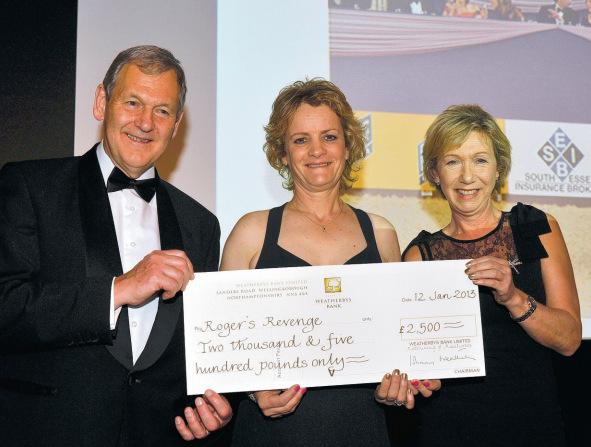 David Buckton and Di Arbuthnot present Vicky Smart with a cheque for Rogers Revenge
