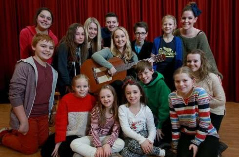 Production lead actress Beth Stobbart (center, Maria Von Trapp) joins fellow cast members Jasper Bruce-Wright, Anna Dias, Abbie Dodsworth, Eleanor Grainger, Abigail Hand, Alice Harwood, Ethan Hurworth, Madison Freya Parkinson, Sophie Ruddick, Toby Shellar