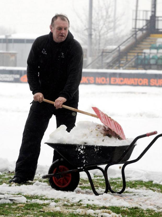 SNOW EFFORT: Director of rugby, Dean Richards last week, lending a hand to clear Falcon's training ground
