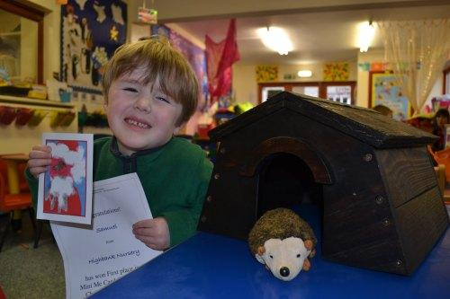 WINNING DESIGN: Samuel Pick with his winning card, certificate and the hedgehog house.