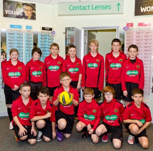 ON THE BALL: Youngsters from Mount Pleasant Rangers Junior Football Club in their new Specsavers-sponsored kits