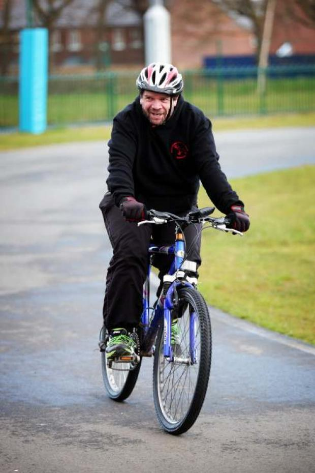 Steven King cycling the distance of the Tour de France at Middlersbrough Cycle Circuit.