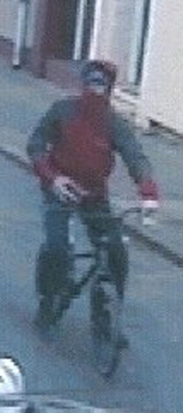 CCTV image of male police are hunting following brick attack