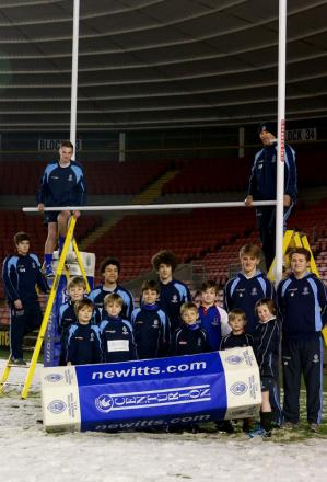 READY FOR ACTION: Squad members from Mowden Rugby Club's academy sides help construct the new posts at The Northern Echo Darlington Arena