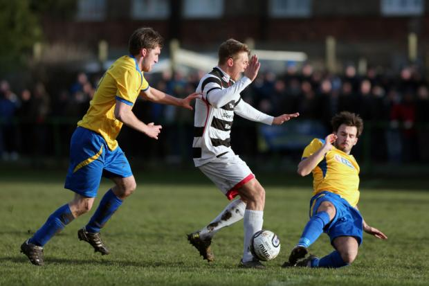 ON THE SLIDE: Darlington's Terry Galbraith is tackled by Marske's Thomas Marron