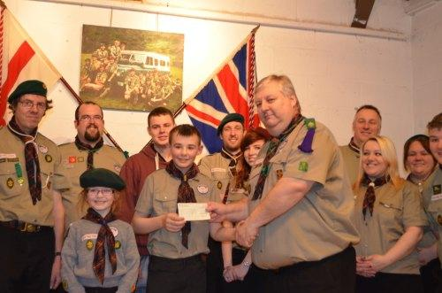 GRATEFULLY RECEIVED: Kieran Maxwell, centre, and his sister Alyssa, left, receive a cheque for £3,300 from Heighington Scouts. Cheque presented by scout master Alan Wilson