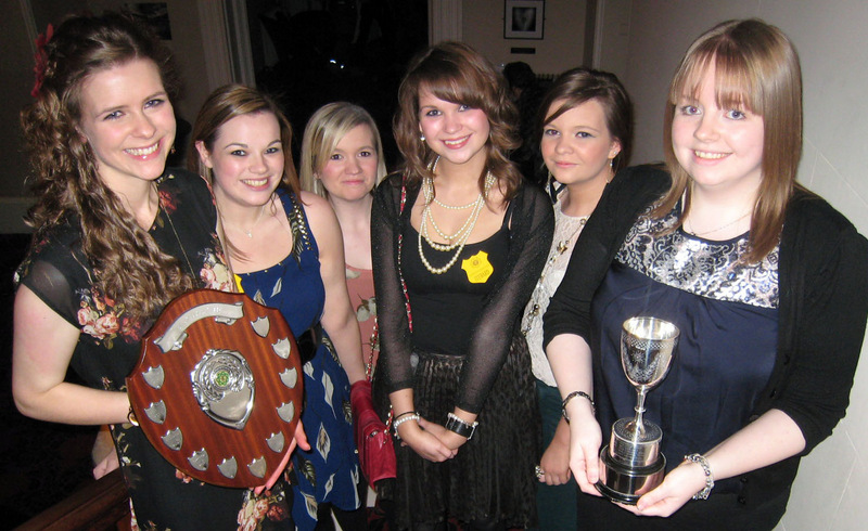 SUCCESS: Julie Blaylock, right, with her Young Farmer of the Year trophy presented at Cumbria YFC North's annual meeting, with members from winning club, Skelton YFC