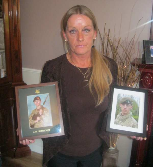 Alison Huggan with photos of her twin sons who are serving in the Army