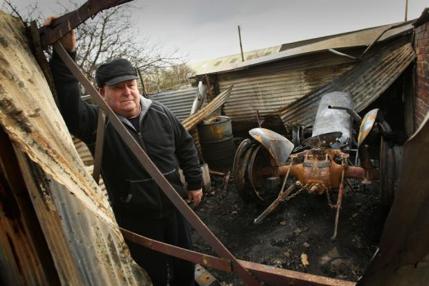 TENTH FIRE: James McLeod assesses the damage at his Billingham allotment