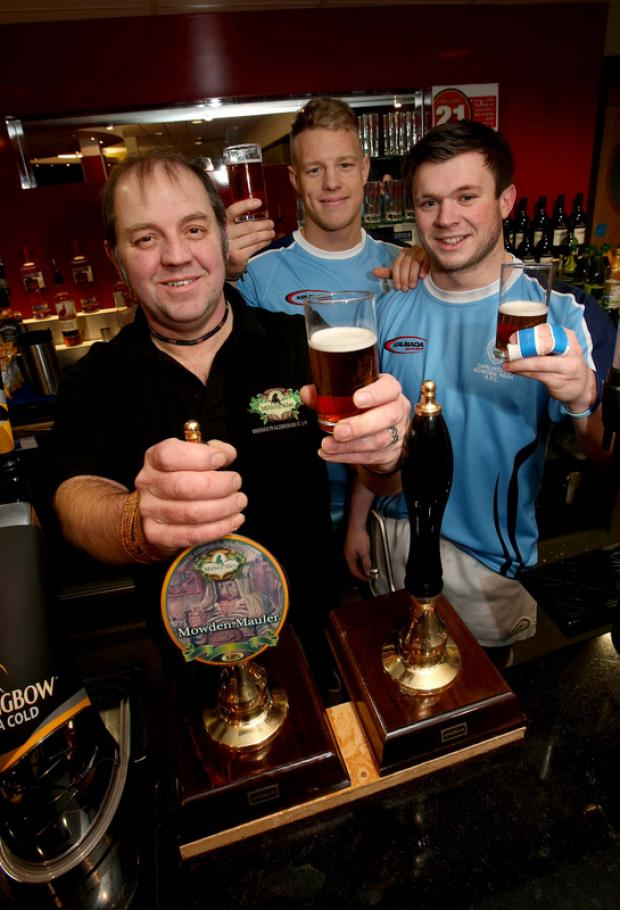 Darlington and Stockton Times: CHEERS TO SUCCESS: Mowden players Shaun McCartney, centre, and Grant Connon join brewer Pete Fenwick to raise a glass of Mowden Mauler