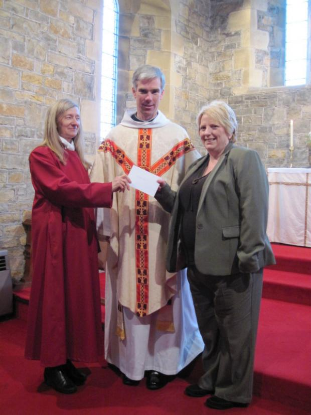 HANDOVER: Sheila Grundy, left, the Rev Ian HunterSmart and Tracy Freeman
