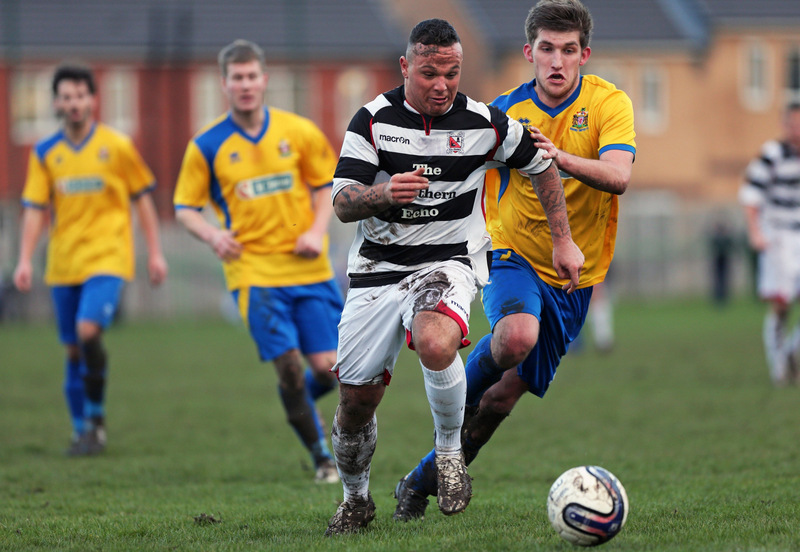 GOING FOR GOAL: Marske's Thomas Marron, right, give chase on Darlington's Stephen Thompson last Saturday