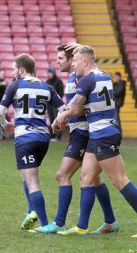 NEW CHAPTER: Mowden try scorer Cameron Mitchell, centre, is congratulated by Shaun McCartney, right, and Chris McTurk. Continued on Page 79 The home side beat Bromsgrove 62-7