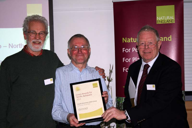 Award-winning volunteers John Worsnop and Peter Ditchburn with Poul Christensen, chair of Natural England.