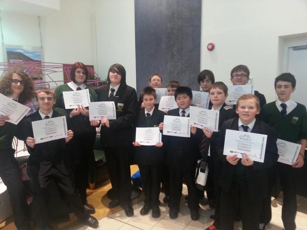 Members of Greenfield's STEM Club show off their certificates