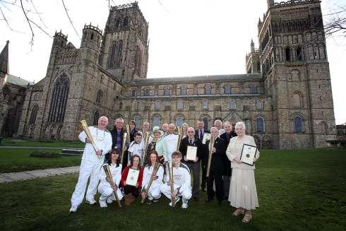 Olympic torchbearers and those connected with the Games with county council chairman, Linda Marshall, outside Durham Cathedral.