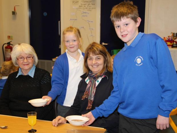 Darlington and Stockton Times: INVITED: Molly Denning and Timmy Jones serve lunch to guests Sylvia Kitching and Diane Nicholson