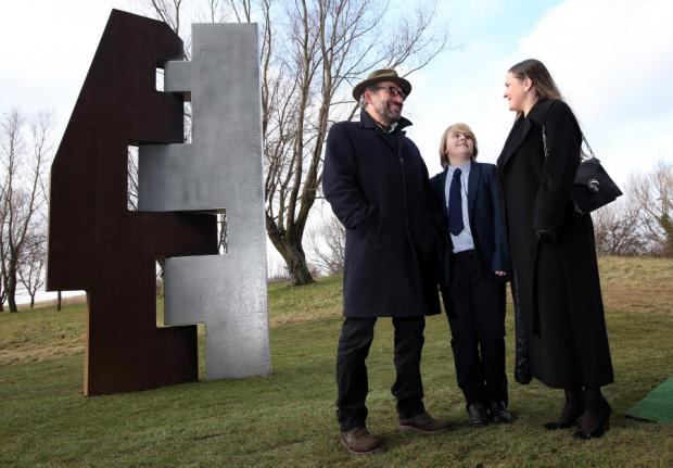 Lewis Robinson, designer of the sculpture pictured at the unveiling with Mr Waterfield's son, Wills, and widow, Sheryl Petite