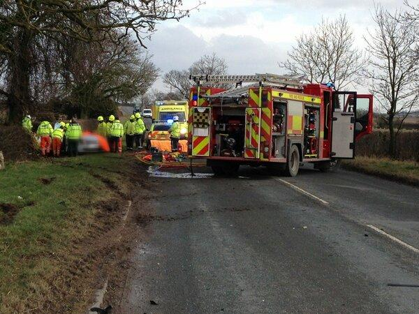 An elderly woman was airlifted to hospital after a car crashed into a hedge between Scorton and North Cowton.