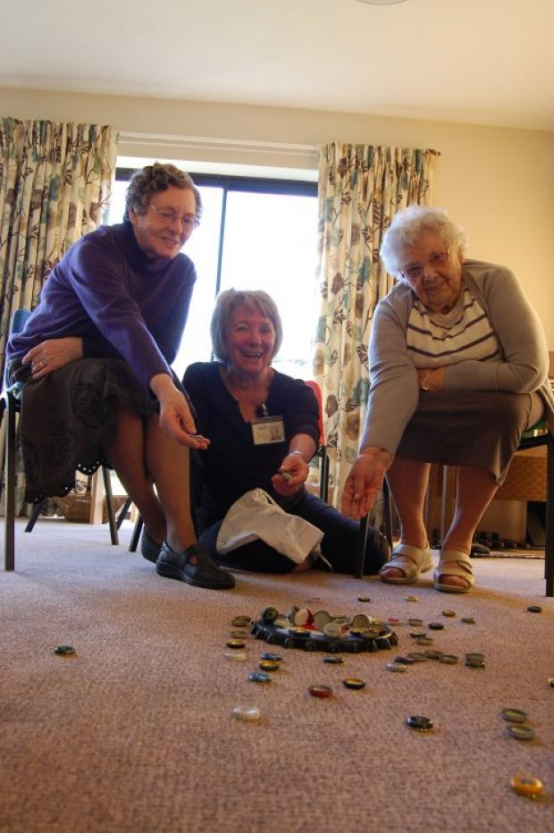 KEEPING ACTIVE: From left, Ivy Holliday, Sue Laycock and Ena Cochrane test their throwing skills