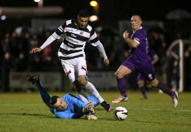 HEAD TO HEAD: Darlington's Amar Purewal is foiled by Spennymoor keeper Robert Dean during their previous meeting this season. It ended 0-0