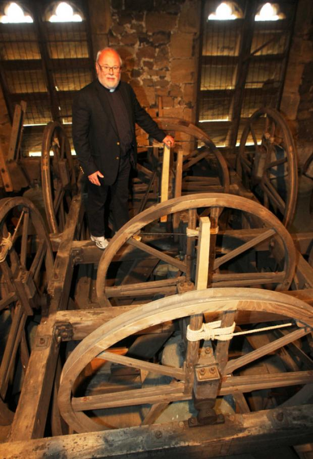 Darlington and Stockton Times: HELP: The Reverend Ian Robinson pictured with the bells in St Gregory's Church in Bedale