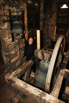 Reverend Ian Robinson pictured with the bells in St Gregory's Church in Bedale