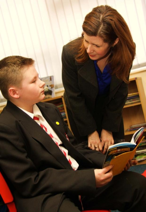 Darlington MP Jenny Chapman discusses the importance of reading with 12-year-old student, Ryan Watt