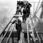 CAREER HIGH: Workers during construction on the Tyne Bridge