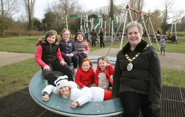 PLAY TIME: Thirsk's Mayor, Councillor Cynthia Hesmondhalgh, tries out some of the new equipment with local children