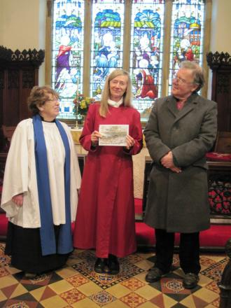 GREETINGS: Doreen Liston, Sheila Grundy and Ian Walton with a copy of the Christmas card