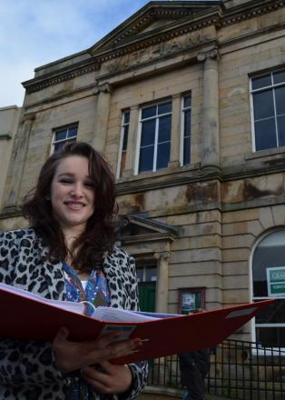 Lara Bissicks conducts research outside the Witham Hall