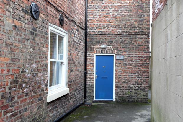CRIME SCENE: The alleyway leading to Jenny Chapman's office