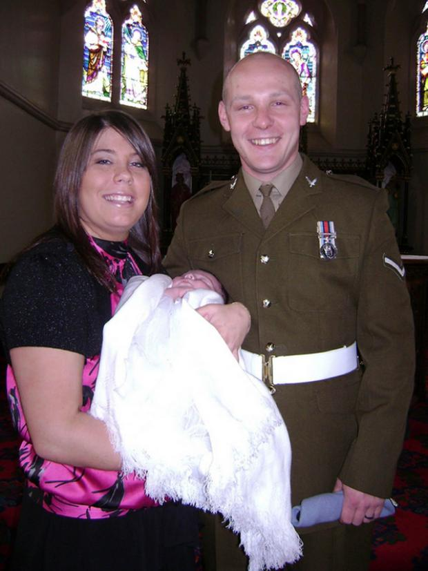 HAPPY FAMILY: Lance Corporal David Kenneth Wilson and his fiancee, Michelle Curry, at the christening of their daughter Poppy