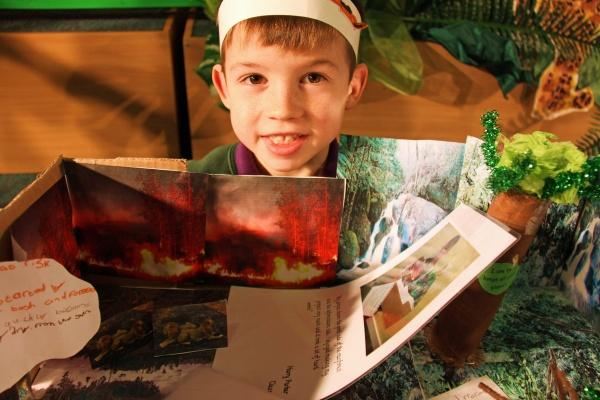 Darlington and Stockton Times: West Park Academy pupil Harry Parker, seven, shows off his forest fire model