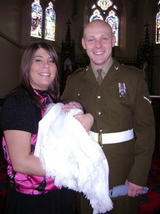 FATAL INJURIES: Lance Corporal David Wilson with his fiancee, Michelle Curry at the christening of their daughter Poppy