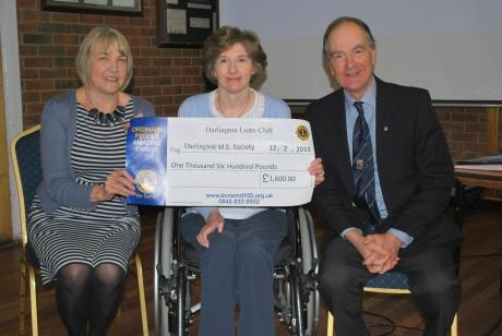 Darlington Lions Club past president Richard Western and Lion Pat DeMartino present Helen Nicholls, chairman of the Darlington branch of Multiple Sclerosis Society, with the £1,600 cheque