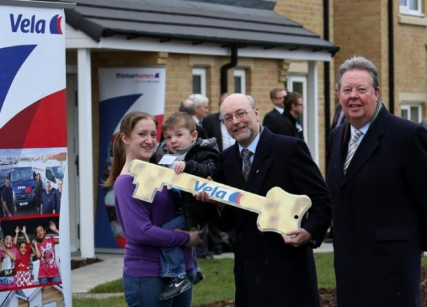 Caption: New residents Lucy Anne Moore and son Kian (aged 3) are handed the keys by local MP Alex Cunningham (centre) and watched by Tristar Homes Chairman John McDougall.