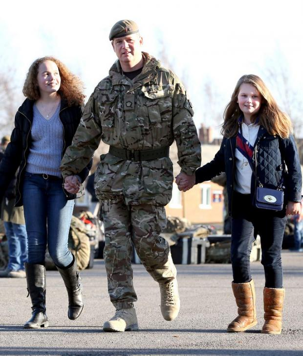 HOME: Troops from the 1st Battalion Scots Guards return after a six-month tour of Afghanistan. Maj Kieran Holling from Bradford is pictured with daughters Isobel, 14, left and Louisa, 11