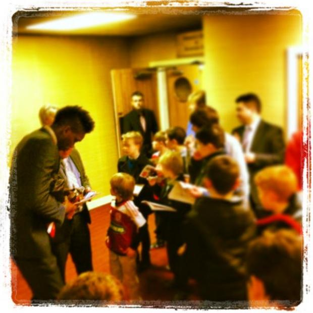 New hero: Sammy Ameobi signs autographs after grabbing his first goal in a Boro shirt.