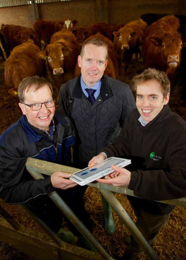 EFFICIENCY TOOL: From left, Stephen Hobbs, beef farmer, Howard Gray of McDonald's UK, and Andy Wynn of The ECO2 project
